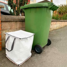 New water tight kerbside recycling bag DRYSACK for paper and card recycling next to wheeled bin